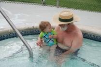 Grandpa and Eliza at pool
