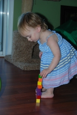 Eliza spent a lot of time stacking small wooden blocks...