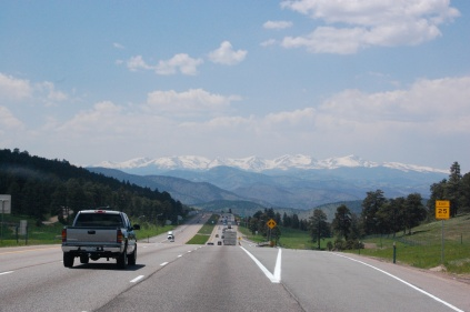 snow capped mountains in the distance along I-70 W