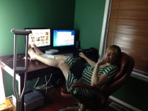 Susie, getting comfortable and elevating her foot while working.