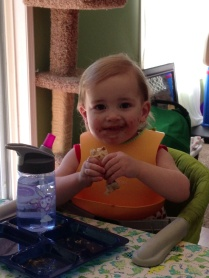 Eliza thoroughly enjoying a peanut butter and jelly burrito.