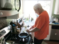 John making yummy chicken vegetable orzo soup