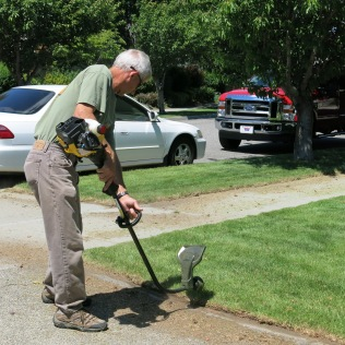 John Crowell hard at work with the edger...