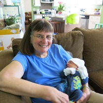 Grandma Holly enjoying holding the small, warm bundle