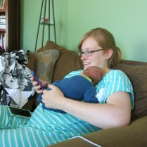 Susie checking email with sleeping baby...