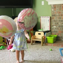 Eliza enjoying the baby balloons..