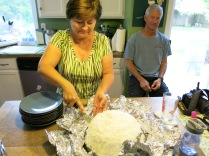 Sherry and her famous coconut layer cake as John looks on...