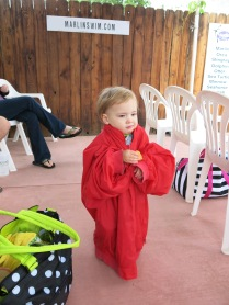 Eliza wearing Grandma Sherry's jacket at swim lessons