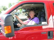 Holly driving Big Red for first time...