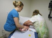 nurse measures Hazel
