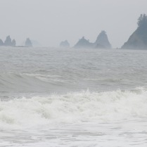 headland rock formations and seastacks through the mist on Rialto Beach