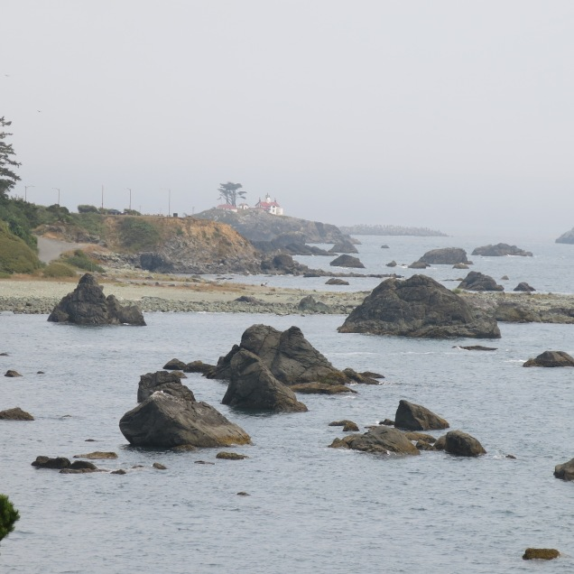 seastacks, shoreline and Battery Point Lighthouse