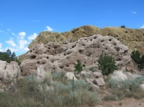 Tuff is an extrusive igneous rock that forms from the tephra ejected during explosive volcanic eruptions.... in Bandelier National Monument, the cliffs of tuff are riddled with caves used by cliff dwellers.