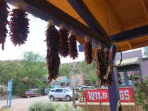 Chile Ristras hanging from the porch beam....