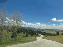 riding through mountains at 10,112 ft elevation - we had sunshine briefly in one direction...