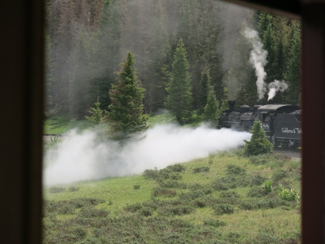 blowing off steam and water to clear the sediment from the boiler