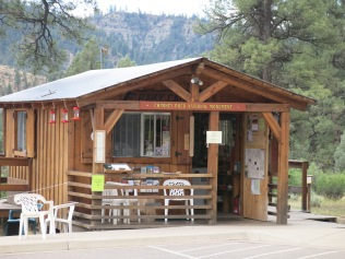 Chimney Rock National Monument Info Cabin - with three busy hummingbird feeders out.