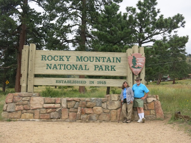 Holly & John at entrance sign