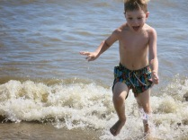at 4.75 yrs old, Hank is very comfortable at the beach in the water....