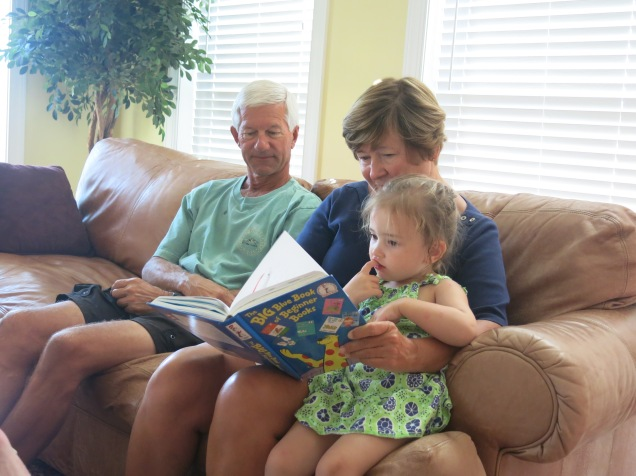 Papaw and Grandma Sherry reading with Eliza