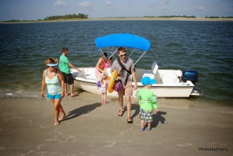 The cousins arrive in the 2nd boatload on the sandbar...