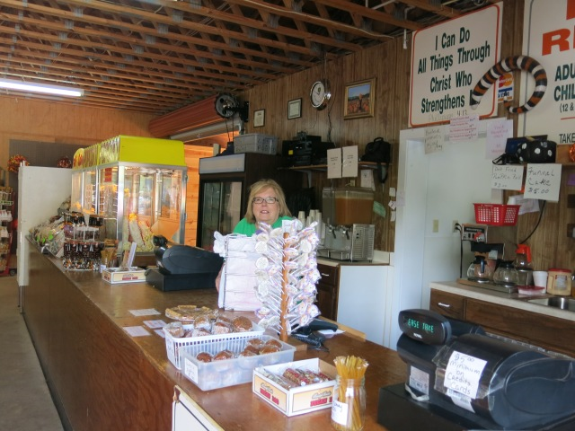 on the counter there is pumpkin pie, pumpkin muffins and Burt's pumpkin roll (among other goodies)
