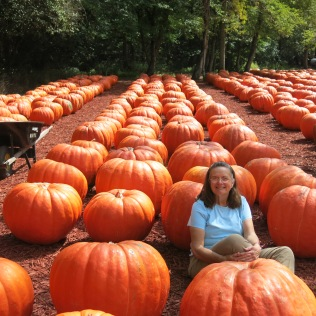 Holly communing with the pumpkins