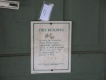 notice on the door of one cottage